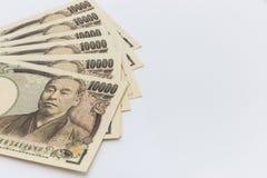Banknotenkonzept der japanischen Yen auf weißem Hintergrund Stockbilder