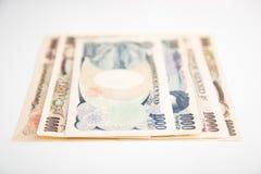 Banknotenweißhintergrund der japanischen Yen Lizenzfreie Stockfotografie