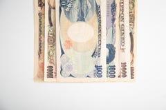 Banknotenweißhintergrund der japanischen Yen Lizenzfreie Stockbilder