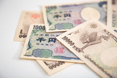 Banknotenweißhintergrund der japanischen Yen Lizenzfreies Stockbild