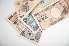 Banknotenweißhintergrund der japanischen Yen Stockbild
