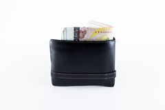 Banknotes of 1000 Thai Baht in black leather wallet. Black leather wallet with Banknotes of 1000 Thai Baht  on white background Royalty Free Stock Images
