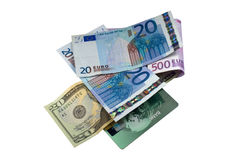 Banknotes. Euro and dollar banknotes scattered around on a white background stock photo