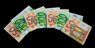 Banknotes 50 and 100 euro. Closeup on black background Royalty Free Stock Photography