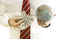 Banknotes And A Globe Royalty Free Stock Photography