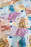 Banknotes Background. Background of euros: ten, twenty, fifty and five-hundred euro banknotes royalty free stock images