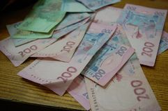 Banknotes. Hryvnia, lying on the office Desk