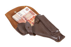 Banknotes in the brown leather holster on white backgro Royalty Free Stock Photos