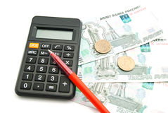 Banknotes, calculator and red pen Royalty Free Stock Images