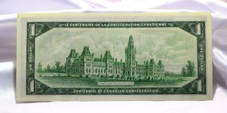 Banknotes of Canada on a white satin background. Stock Photo