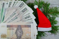 Banknotes on Christmas gifts - Christmas shopping Stock Photo