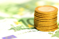 Banknotes and coins Stock Photography