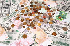 Banknotes and coins of different countries Royalty Free Stock Photos
