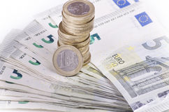 Banknotes and coins Stock Photos