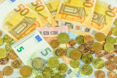 Banknotes and coins in euros Royalty Free Stock Photography