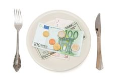 Banknotes and coins on the plate. Euro and dollar bills and coins on the plate, on white background royalty free stock photos