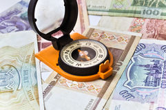 Banknotes and compass. Navigation in the world of Finance. Stock Photography
