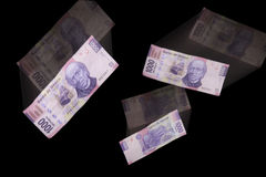 Banknotes. The concept of currency devaluation on the stock market with mexican banknotes over black background Stock Photo