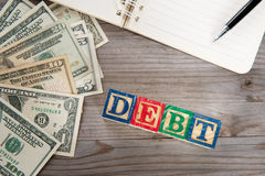 Banknotes and debt word. Stock Photo