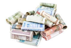 Banknotes of different countries. Some rolled bank papers of different countries, clipping path Stock Photos