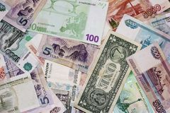 Banknotes of different countries are a bunch of alternately. Rubles, dollar, Euro, yuan. royalty free stock photo