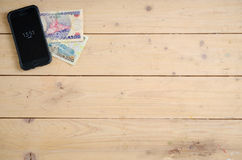 Banknotes different countries on the wooden table Royalty Free Stock Image
