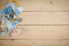 Banknotes different countries on the wooden table Royalty Free Stock Images