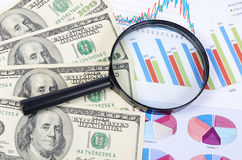 Banknotes of dollar with chart Royalty Free Stock Photography