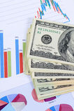 Banknotes of dollar with chart Stock Photography
