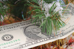 Banknotes dollar and Christmas tree Royalty Free Stock Photo