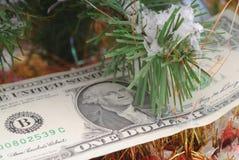 Banknotes dollar and Christmas tree Royalty Free Stock Photo