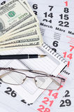 Banknotes of dollars on calendar sheets closeup Stock Image