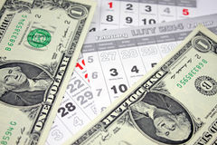 Banknotes of dollars on calendar sheets closeup Stock Photo