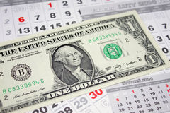 Banknotes of dollars on calendar sheets closeup Royalty Free Stock Image