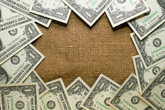 Banknotes dollars lined old cloth in a circle Stock Photo