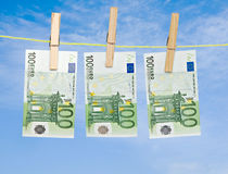 Banknotes drying  on rope Royalty Free Stock Photography