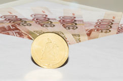 Banknotes in envelope and coin is close Stock Photo