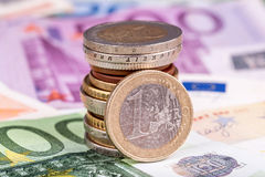 Banknotes and euro coins Stock Image