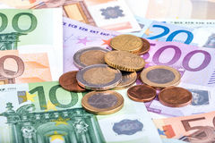 Banknotes and euro coins Royalty Free Stock Photo