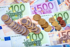 Banknotes and euro coins Stock Photo