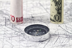 Banknotes of the Euro and the dollar with compass Royalty Free Stock Image