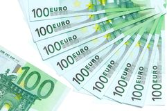Banknotes of 100 euro are located around. As fan and part of 100 euro banknote on a white background Stock Images