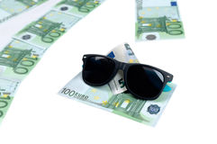 Banknotes of 100 euro and sunglasses Royalty Free Stock Photo