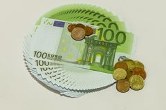 Banknotes of 100 euros,listed in the correct circle and cents. On white background Stock Photos
