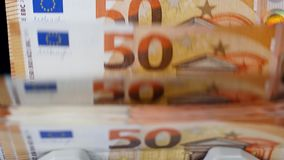 Banknotes of euros are moving inside of a counting device. 4K stock video