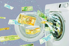 Banknotes falling out from the washing machine Royalty Free Stock Image