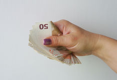 Banknotes in the female hand Royalty Free Stock Images