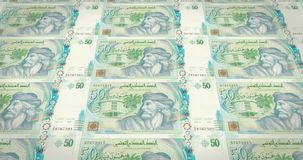 Banknotes of fifty tunisian dinars of Tunisia, cash money, loop. Series of banknotes of fifty tunisian dinars of the Central Bank of Tunisia rolling on screen royalty free illustration