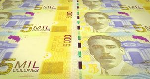 Banknotes of five thousand colones of Costa Rica, cash money, loop. Series of banknotes of five thousand colones of the bank of Costa Rica rolling on screen stock illustration