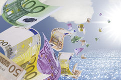 Banknotes flying over the sea. This image shows a few bank notes floating on the sea and into the sun Stock Photos